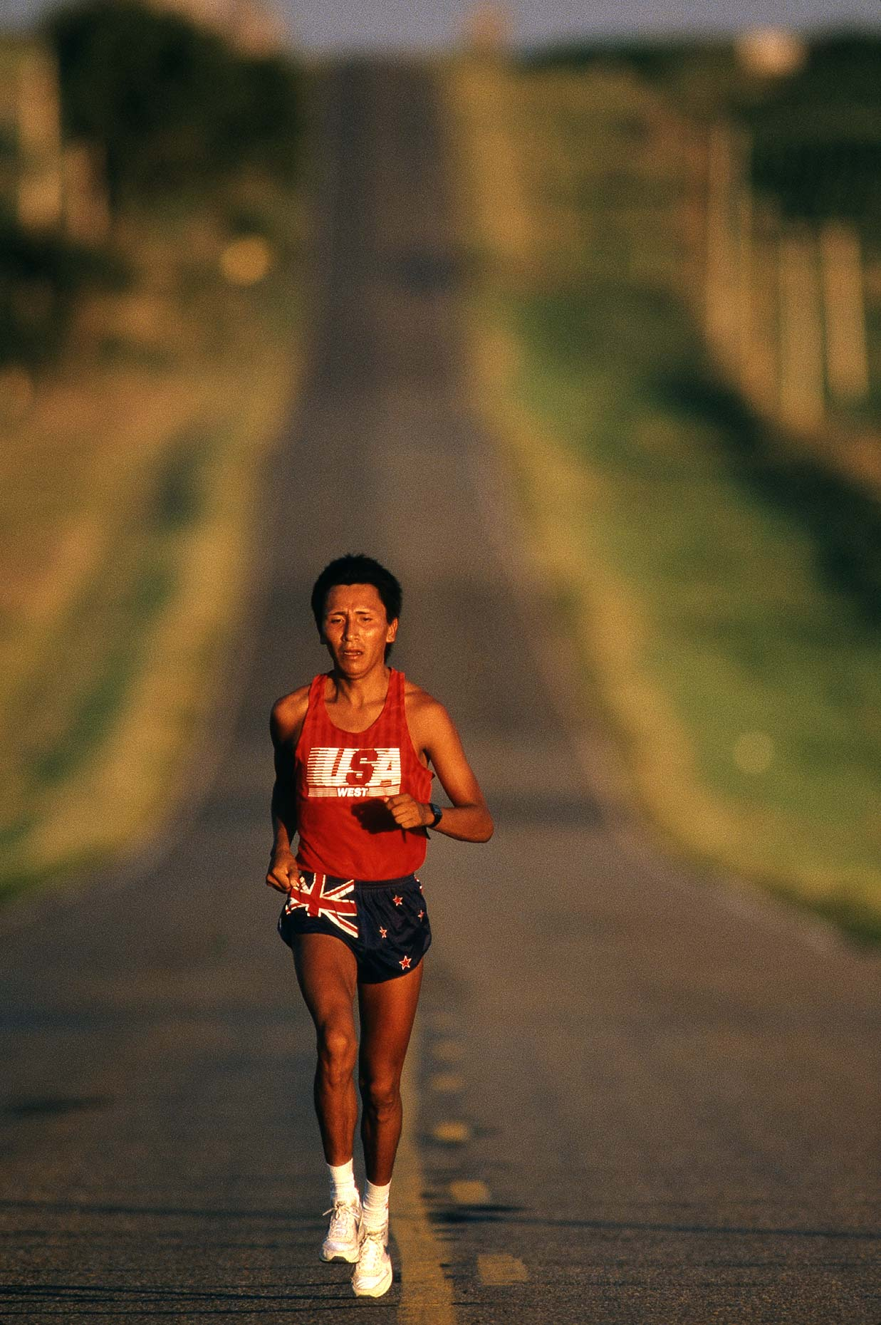 A native American runner trains on a road on the Rosebud Indian Reservation.