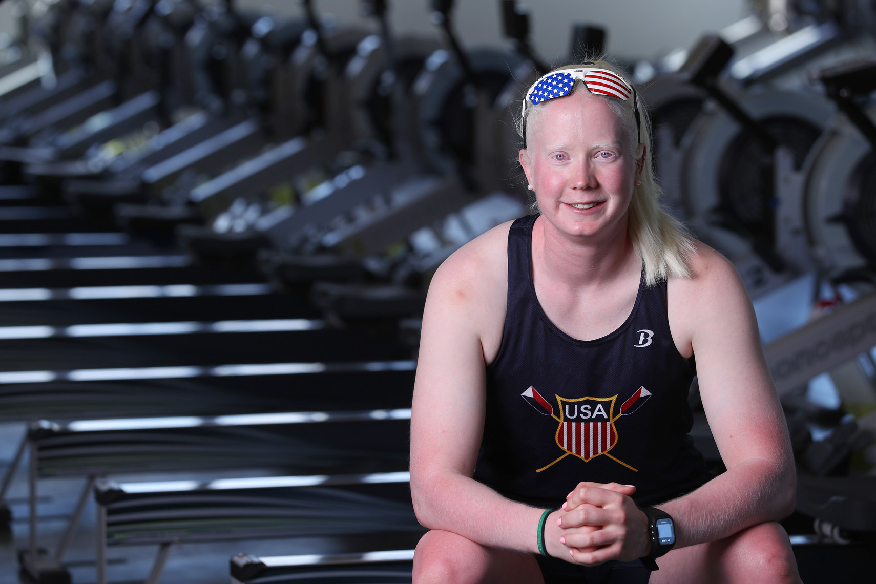 Olympic para rower Jaclyn Smith poses for a portrait in a workout room at Community Rowing.