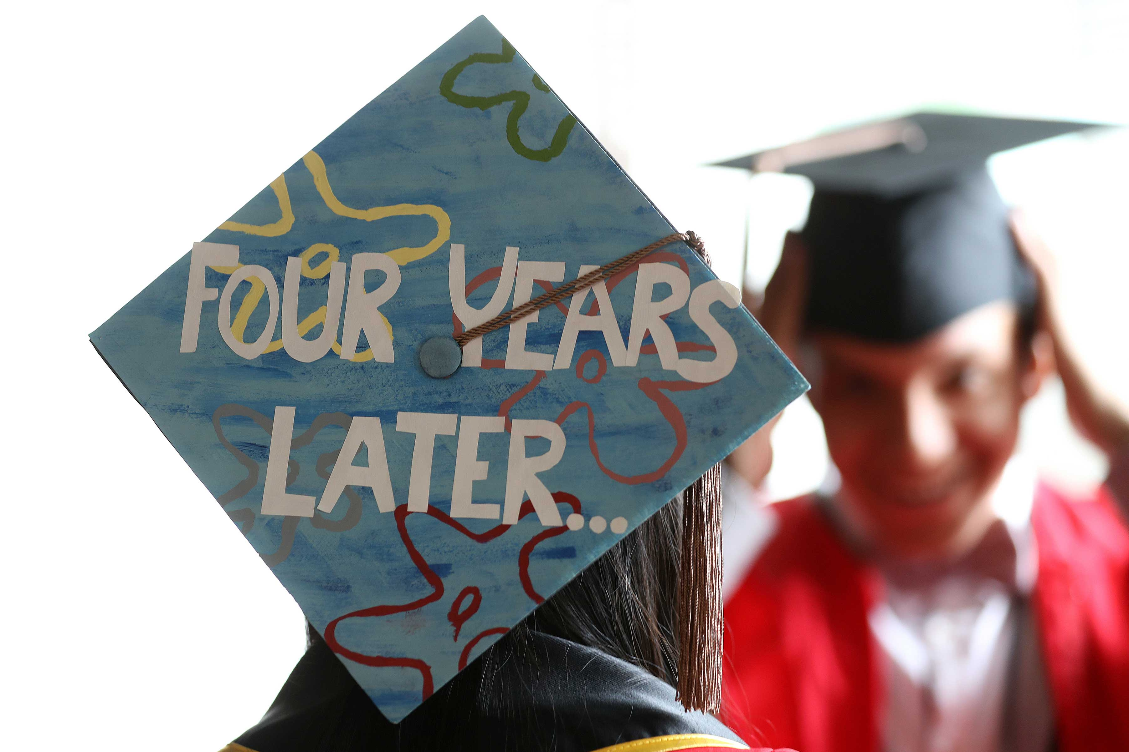 A mortar board spells out the journey of a recent graduate of Boston University.