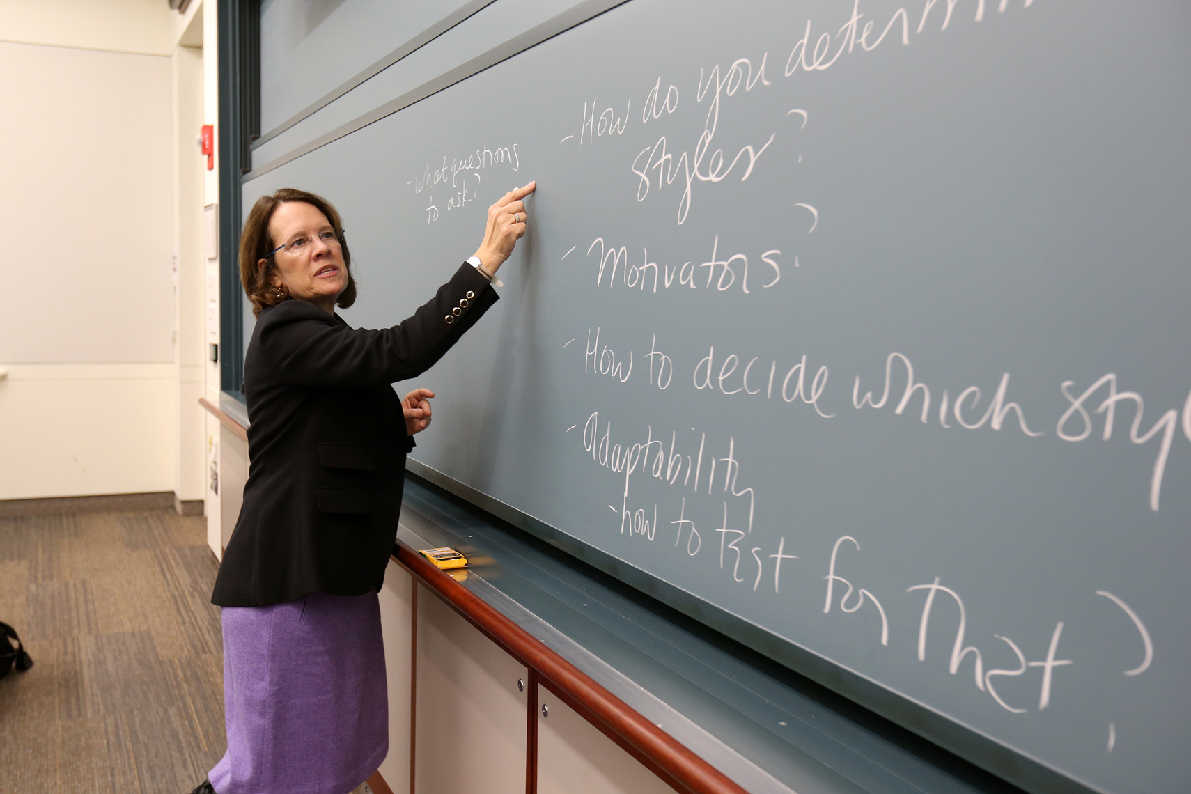 A professor uses the chalkboard to define a lesson during a class at Boston Univ.