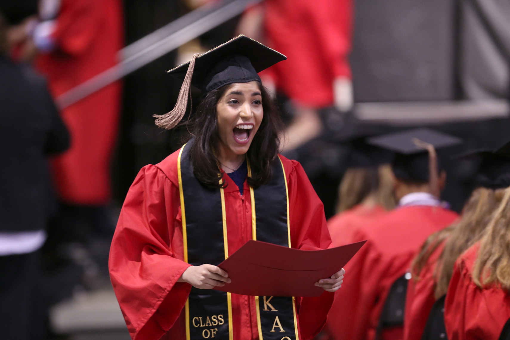 A Boston University graduate shows her emotions after receiving her diploma.