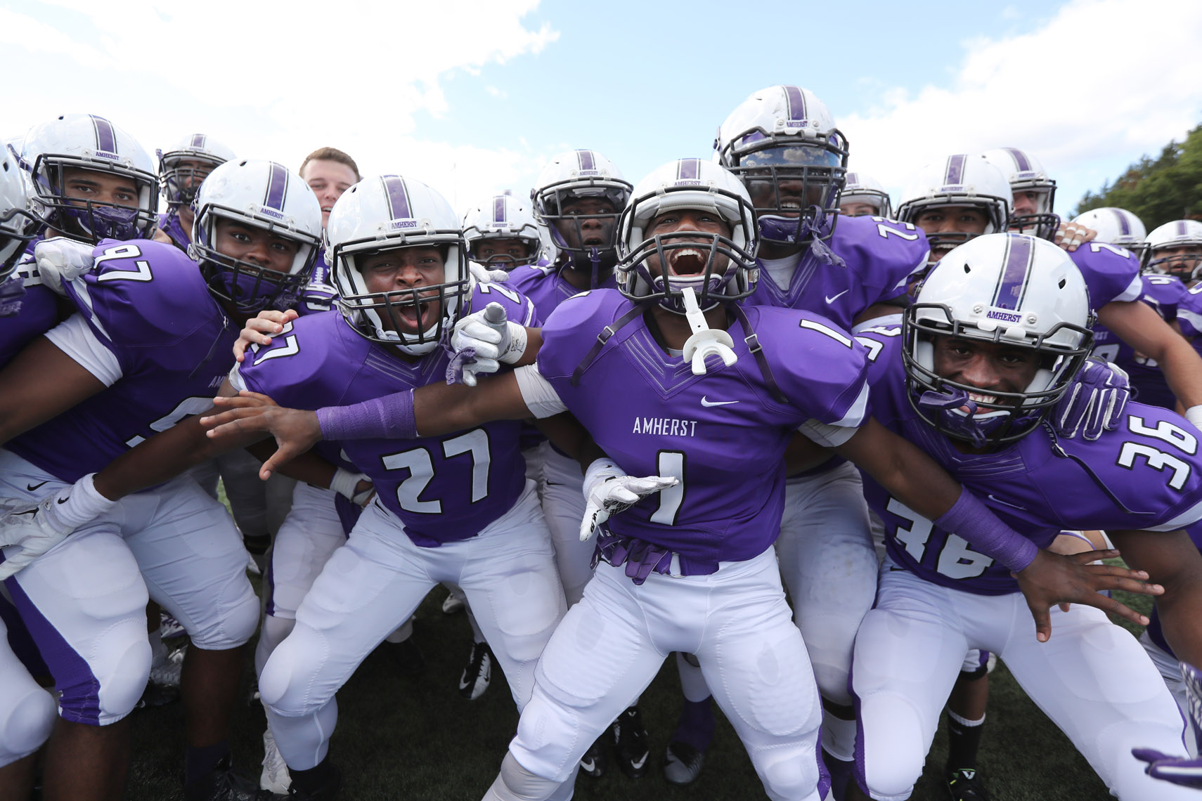 Amherst College football players celebrate a victory over Hamilton.
