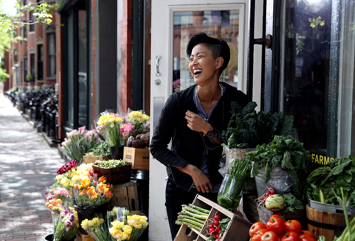 Kristen Kish, a celebrity chef  shops for vegetables in Boston