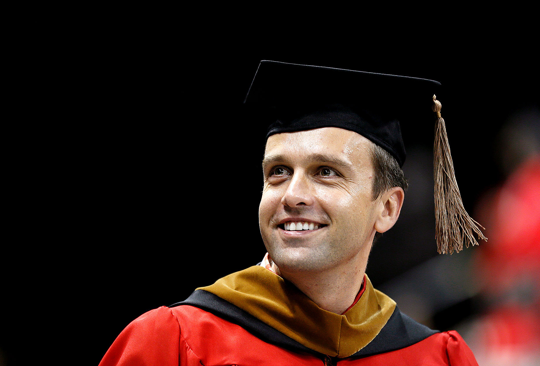 A Boston University MBA graduate searches the crowd for his family.