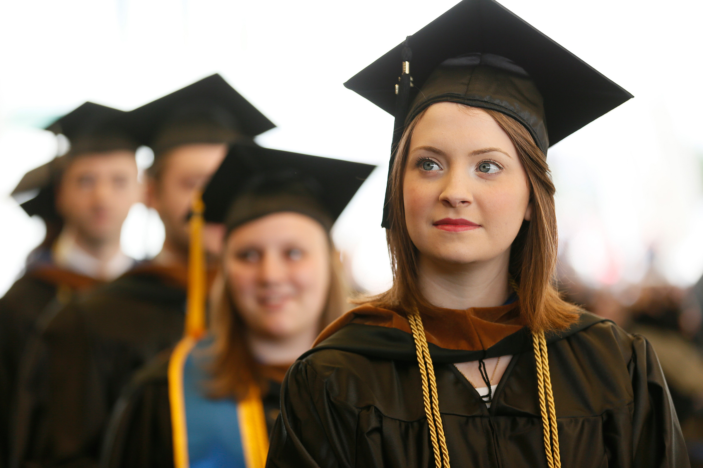 Graduate Hannah Lapuck listens to speakers during Commencement Services for Suffolk University.