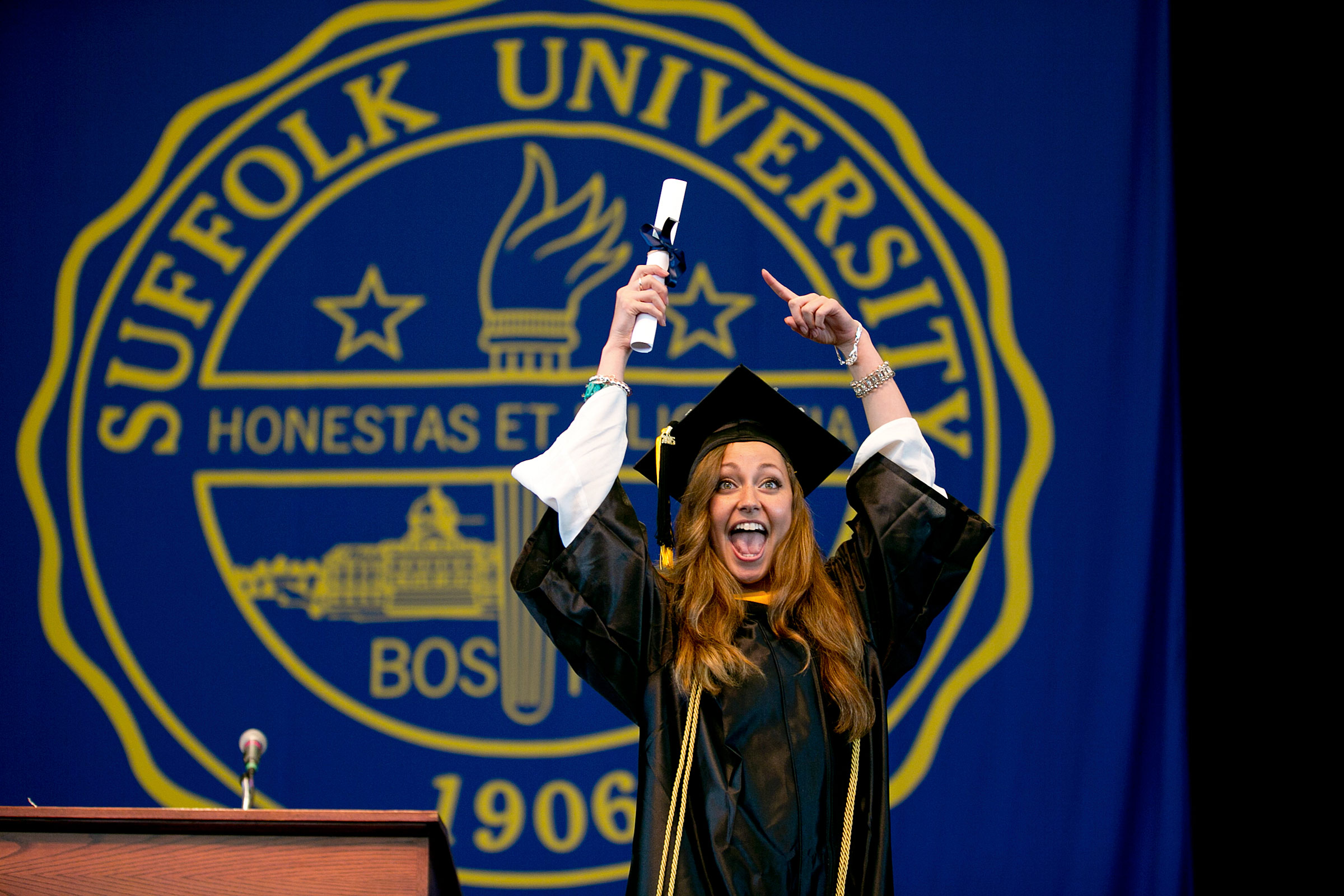Newly  graduated from Suffolk Univ. a student shows her feelings to the crowd.