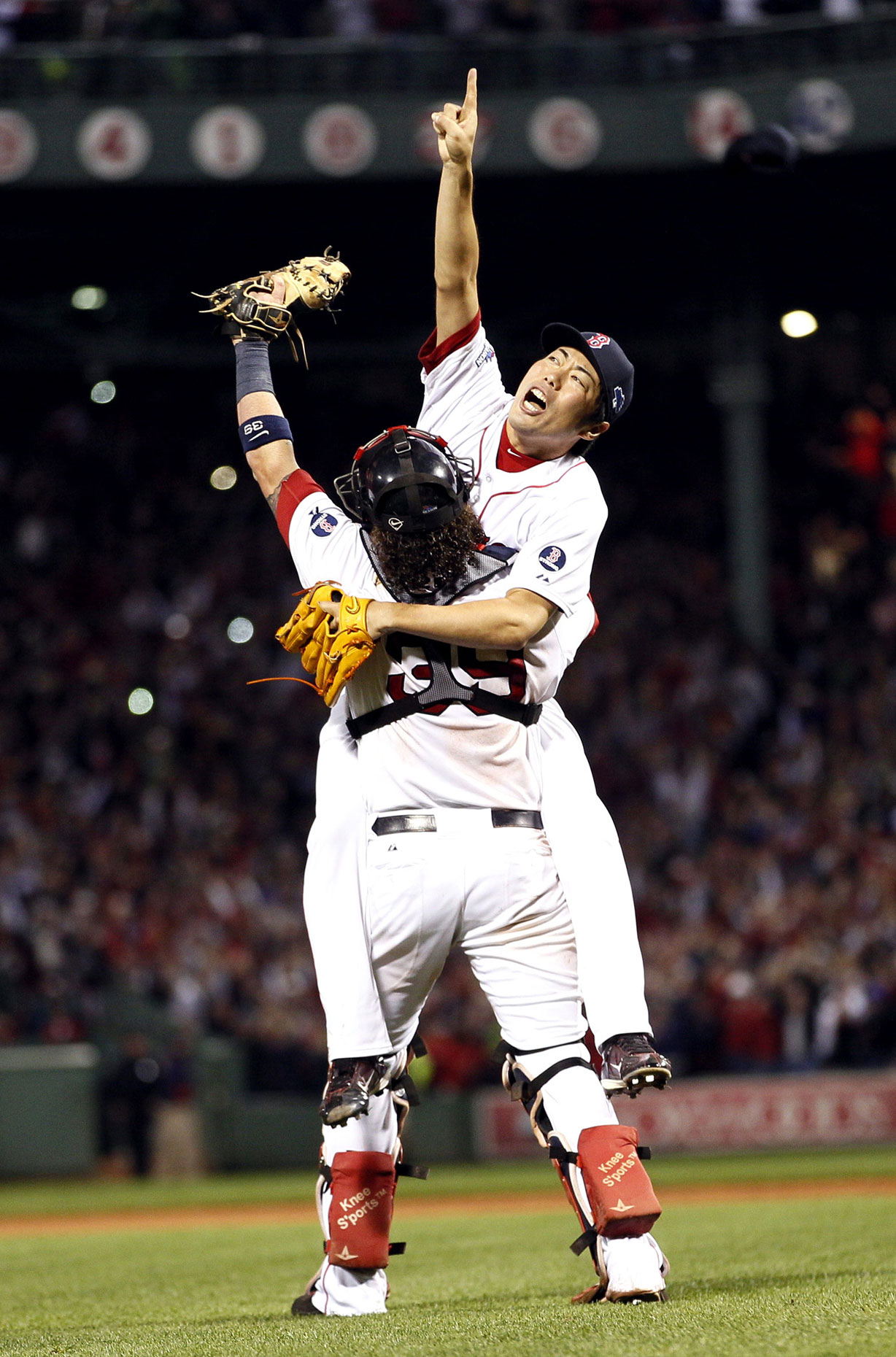 Koji Uehara celebrates after Boston defeated St. Louis  for the World Series title.