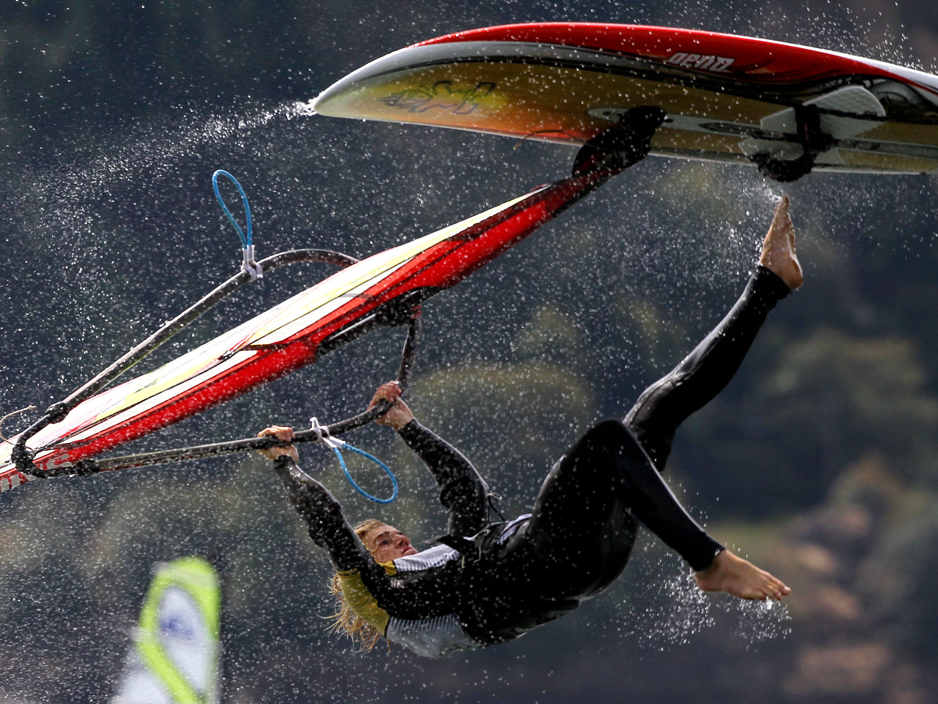 Water drips from the board as a windsurfer catches some air in the Columbia River.