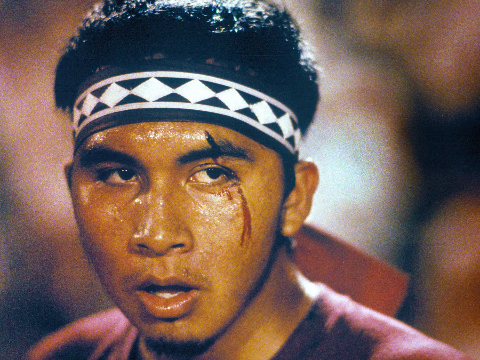 A member of the Choctaw tribe sports a cut over his eye during a stickball game.