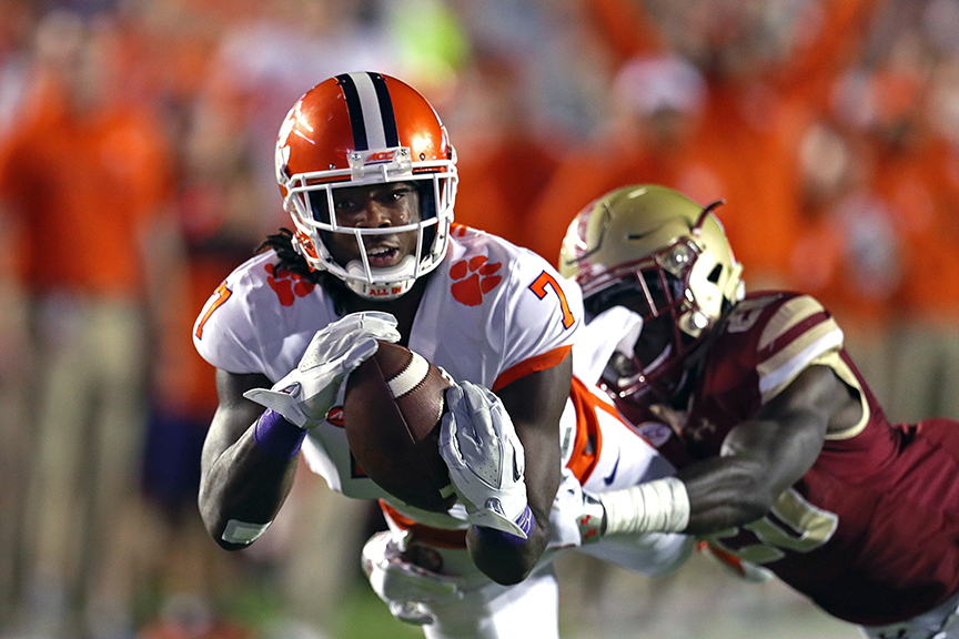 Clemson receiver Mike Williams makes a catch for a long gainer during a college football game against Boston College.